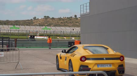 gt : Bumblebee Ferrari F12Berlinetta coming from the track. Beautiful yellow Ferrari.