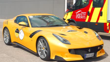 wasp : Bumblebee Ferrari F12Berlinetta coming from the track. Beautiful yellow Ferrari.