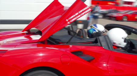 tuned : Red Cabrio Ferrari 458 Spider coming from the track. Espersen team. Ferrari Challenge 2019, Spain. Stock Footage