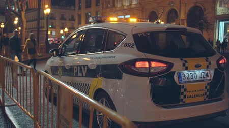 acil : A Spanish  Valencian local Police Car patrolling Valencia city during night.  Night patrol. Stok Video