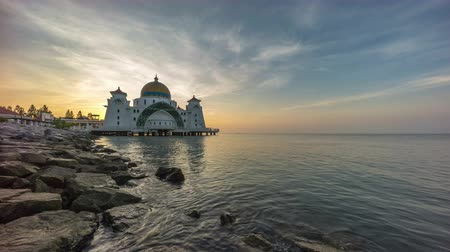 masjid selat melaka : timelapse 4k footage of a beautiful sunrise at Melaka Strait Mosque with moving and changing color clouds. Stock Footage