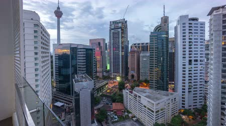 cityspace : Kuala Lumpur, Malaysia- circa October 2015 :Beautiful Day to Night Sunrise Scene Over Kuala Lumpur City. Time Lapse. Showing the Famous Kuala Lumpur Tower and other bulding nearby. Tilt up. Stock Footage
