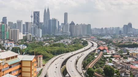 subir : Time lapse footage of road lead to Kuala Lumpur city center. Tilt up.