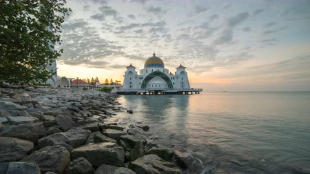 masjid selat melaka : time lapse. sunrise at a mosque by the sea