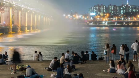 han river : Rainbow fountain show at Banpo Bridge in Seoul, Korea. tilt up