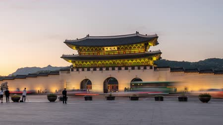 gyeongbok : Beautiful dusk scene of Gwanghwamun Gate at Gyeongbokgung Palace. Panning Stock Footage