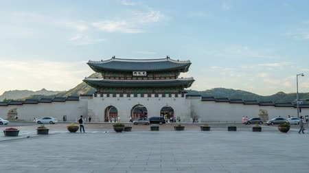 gyeongbok : Time lapse of Gwanghwamun gate of Gyeongbokgung Palace in Seoul, Korea.  Pan right to left