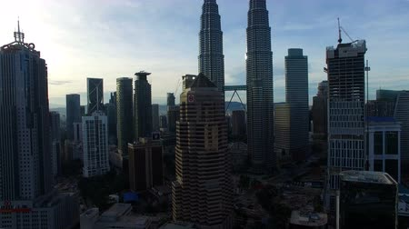 uzun boylu : Flying rising up View Of Kuala Lumpur City In Malaysia Capital, Tall Buildings. Cinematic Stok Video