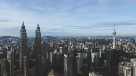 drone : Flying rising up View Of Kuala Lumpur City In Malaysia Capital, Tall Buildings. Cinematic Stock Footage