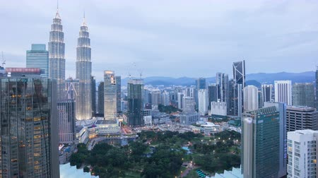 kuala lumpur skyline : Time lapse of day to night sunset scene at skyline. View from high level building. Pan left