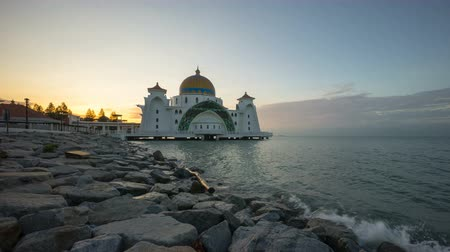 masjid selat melaka : Time lapse 4k Footage of Beautiful Sunrise At Malacca Straits Floating Mosque, or Masjid Selat Melaka. Showing a moving and changing color clouds. Zoom in Stock Footage
