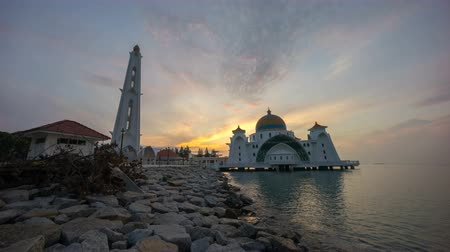 masjid selat melaka : Time lapse 4k Footage of Beautiful Sunrise At Malacca Straits Floating Mosque, or Masjid Selat Melaka. Showing a moving and changing color clouds.