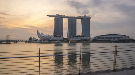 campbell : Hyper lapse time lapse of sunrise at Marina Bay Singapore with city skyline reflections. Stock Footage
