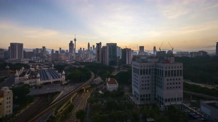 malásia : 4k UHD time lapse of sunrise night to day scene at Kuala Lumpur city skyline. Tilt up