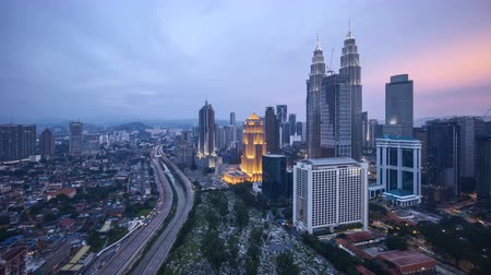 tilt : 4k UHD time lapse of aerial view sunset day to night at Kuala Lumpur city skyline. Tilt up Stock Footage