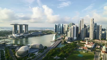 4k UHD time lapse of cloudy sky scene at Marina Bay Singapore. Tilt down