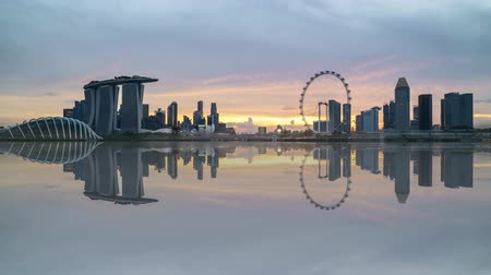 night singapore : 4k UHD time lapse of beautiful sunset at Marina Bay Singapore city skyline with reflection effect. Tilt down