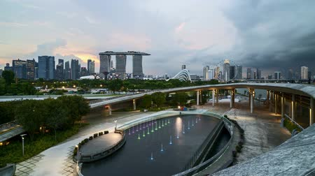 night singapore : 4k UHD time lapse of sunset sky day to night at Singapore Marina Bay city skyline. Tilt down