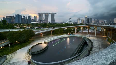 crossing road : 4k UHD time lapse of sunset sky day to night at Singapore Marina Bay city skyline. Pan right