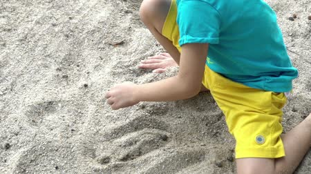 sea play : Slow motion footage of asia (melayu) Malaysian boy playing sand at a beach. Stock Footage