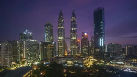 malásia : 4k time lapse of sunrise scene at Kuala Lumpur city skyline. Pan right