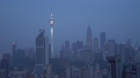 distrito financeiro : Kuala Lumpur, Malaysia - September 17, 2018: 4k establishing cinematic shot of blue hour hazy morning at Kuala Lumpur city skyline.