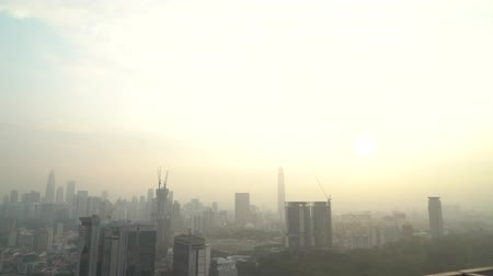 quatro : 4k establishing cinematic shot of sunrise blue hour hazy morning at Kuala Lumpur city skyline.