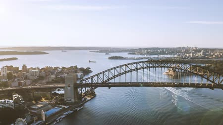 ferry terminal : 4k aerial hyperlapse drone lapse of Sydney city skyline during sunrise. Aerial view with cinematic establishing shot and flare effect. Tilt down