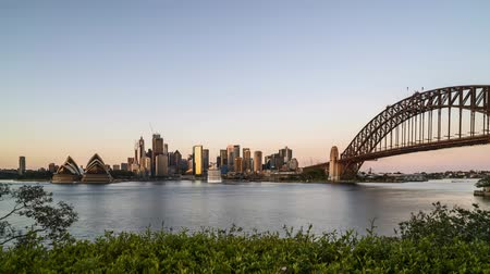 balsa : 4k UHD time lapse of night to day sunrise at Sydney city skyline. Tilt down