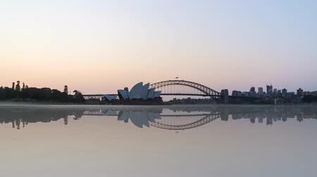 balsa : 4k UHD time lapse of beautiful sunrise night to day at Sydney with reflection effect. Tilt down