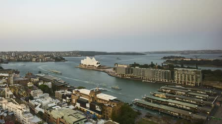 Сидней : 4k UHD time lapse of day to night to day (from sunset to sunrise) at Sydney city skyline, aerial view. Tilt down