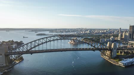 ferry terminal : 4k aerial hyperlapse drone lapse of Sydney city skyline during sunrise. Aerial view with cinematic establishing shot. Tilt down
