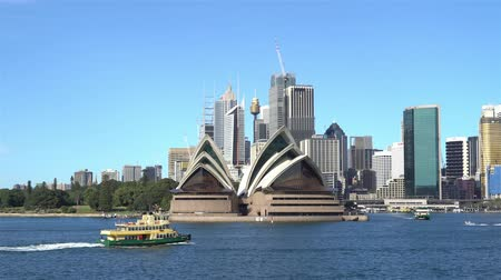 domki : 4k cinematic establishing b-roll shot of Sydney Opera House and surrounding building during bright day light.