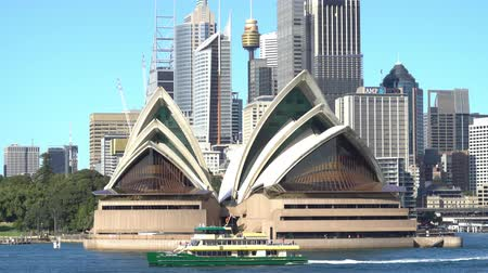 australian landscape : 4k cinematic establishing b-roll shot of Sydney Opera House and surrounding building during bright day light.