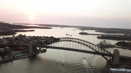 aussie : 4k aerial cinematic drone footage b-roll of Sydney Harbour Bridge during sunrise.