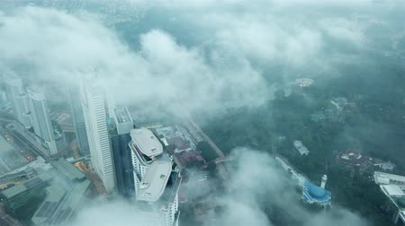 city park : 4k b-roll cinematic establishing shot. Aerial drone view of sunrise at Kuala Lumpur city skyline.