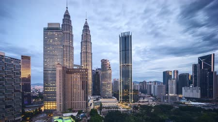 gezi : 4k time lapse of sunrise at Kuala Lumpur city skyline. Pan right