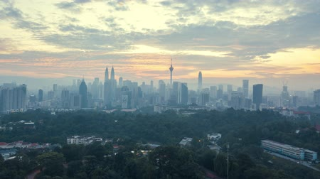 kuala lumpur skyline : aerial drone lapse hyperlapse of sunrise at Kuala Lumpur city skyline horizon. Cinematic establishing b-roll shot of drone flying over Kuala Lumpur. Tilt up Stock Footage