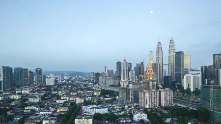 kuala lumpur skyline : 4k time lapse of day to night to day, from sunset to sunrise at Kuala Lumpur city skyline, aerial view. Zoom out Stock Footage