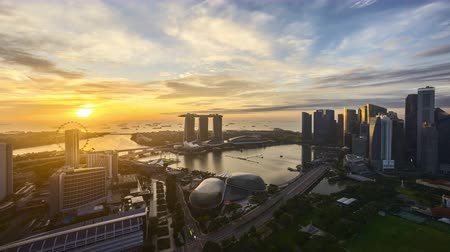 4k UHD time lapse of night to day sunrise scene at Singapore city skyline. Zoom in