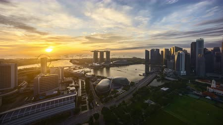 4k UHD time lapse of night to day sunrise scene at Singapore city skyline.