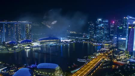 Time lapse of fireworks show at Singapore Marina Bay. Pan left
