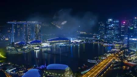 Time lapse of fireworks show at Singapore Marina Bay. Pan right