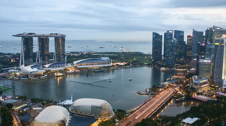 Time lapse of sunset day to night at Singapore Marina Bay skyline. Zoom out