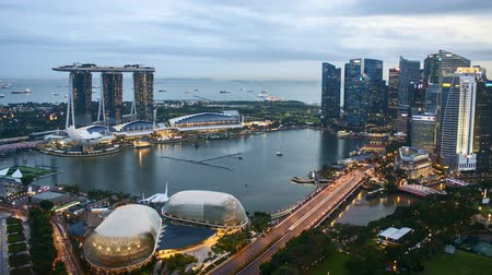 Time lapse of sunset day to night at Singapore Marina Bay skyline.