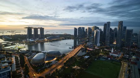 Time lapse of night to day sunrise at Marina Bay Singapore.