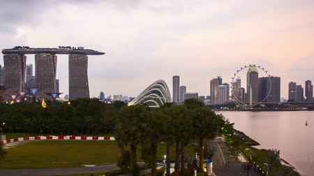 Time lapse of dusk day to night sunset at Marina Bay Singapore. Pan left