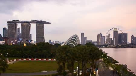 Time lapse of dusk day to night sunset at Marina Bay Singapore. Pan right