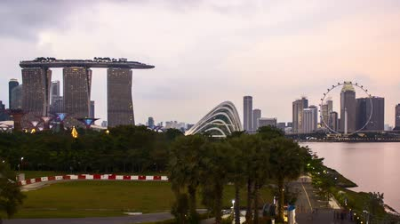 Time lapse of dusk day to night sunset at Marina Bay Singapore. Zoom out