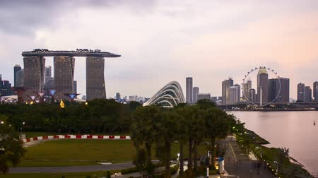 Time lapse of dusk day to night sunset at Marina Bay Singapore. Zoom in